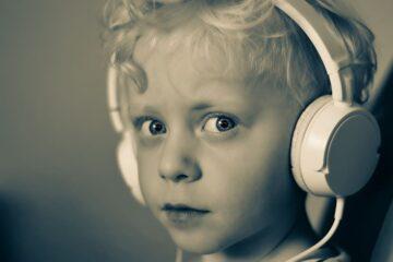 child with headphones boy child headphones white music