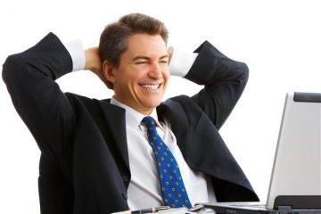 happy man looking at computer